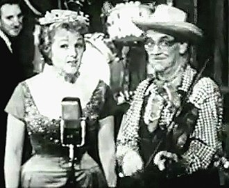 "Red Ingle - Jo Stafford as Cinderella G. Stump and Ingle performing their 1947 hit, ""Tim-Tay-Shun"", on Startime in 1960."