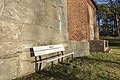 Tjøme kirke Church nygotisk langkirke 1866 Architect Anders Thorød Winter afternoon light No snow Færder Vestfold Norway Vegg mur Wall Parkbenk Kirken Bench 2020-01-20 2033.jpg