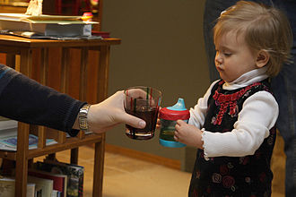 Sippy cup - Sippy cup held by a child