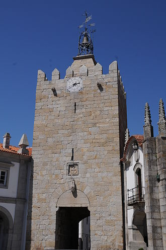 Caminha - Old castle keep of Caminha, turned into a public clock tower in the 17th century. Its gate leads to the historical centre. The building to the right is the municipality.