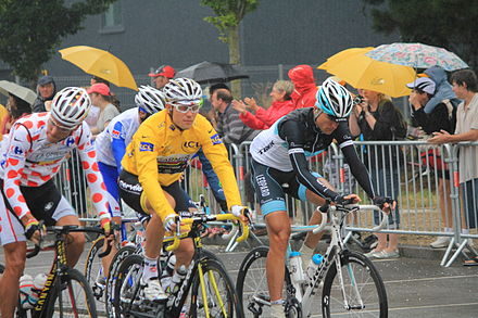 Hushovd (in yellow) at the 2011 Tour de France. Hushovd held the overall lead of the race from the second to the ninth stage of the race. Tour de France 2011 - Lorient - 9535.JPG