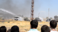 Turkish border guards disperse protesters in Kobanî.png