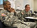 U.S. Army Maj. Gen. Augustus L. Collins, left, the adjutant general of Mississippi, and Col. Lee Smithson, the director of military support, listen to updates on the response to Hurricane Isaac from Mississippi 120829-Z-VU198-002.jpg