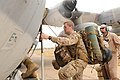 U.S. Marine Corps Staff Sgt. James Cook, right, a flight engineer with Marine Aerial Refueler Transport Squadron (VMGR) 234, guides Navy Religious Program Specialist 3rd Class Christopher Grigoletti, with 120411-M-ZD965-290.jpg