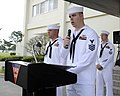 "U.S. Navy Aviation Ordnanceman 1st Class William Kenney, at lectern, selected for promotion to chief petty officer, reads a poem entitled, ""United We Stand,"" during a 9-11 remembrance ceremony at Naval Air 120911-N-ZI955-114.jpg"