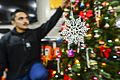 U.S. Navy Fire Controlman 3rd Class Brandho Linao hangs a snowflake on a Christmas tree aboard the guided missile cruiser USS Monterey (CG 61) Dec. 15, 2013, in the Mediterranean Sea 131215-N-QL471-084.jpg