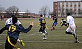 U.S. Navy Lt. Cmdr. Alex Hampton, center, a student at the U.S. Naval War College (NWC), passes the ball during an Army-Navy flag football game at Nimitz Field at Naval Station Newport in Newport, R.I., Dec. 6 131206-N-PX557-522.jpg