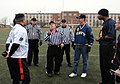U.S. Navy Rear Adm. Walter E. Carter Jr., third from right, the president of the U.S. Naval War College (NWC), watches the coin toss before an Army-Navy flag football game at Nimitz Field at Naval Station 131206-N-PX557-501.jpg