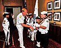 U.S. Navy Rear Admiral Michael H. Miller, Chief of Legislative Affairs, shakes hands with 11 year-old Navy League Cadet Ryan McFadden.jpg