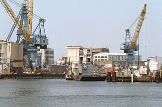 Virginia-class cruiser - Virginia in drydock at Norfolk; the ship's superstructure has been removed and replaced by containment vessels to allow the safe removal of her nuclear reactors