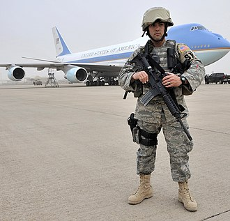 USAF Security Forces airman guarding Air Force One on the flight line in Iraq, 2009 US Air Force 090407-F-1125C-210 President Obama visits Sather.jpg