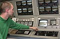 US Navy 020324-N-0659H-002 USS Kitty Hawk Sailors monitors the ship's ILARTS system.jpg