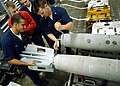 US Navy 020807-N-2147L-003 Sailors aboard CVN 73 dismantal a MK-82 bomb in one of the ship's magazines.jpg
