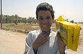 US Navy 030405-A-0000F-004 An Iraqi boy shows off the Humanitarian Daily Ration he just received from soldiers of the 82nd Airborne Division operating in central Iraq.jpg