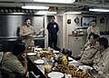 US Navy 030424-N-0715P-099 Master Chief Petty Officer of the Navy (MCPON) Terry Scott addresses the Chief's Mess before chow while aboard the guided missile cruiser USS Port Royal (CG 73).jpg
