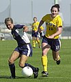 US Navy 030907-N-9693M-004 Navy midfielder Ariana Downs tries to steal the ball from Drexler defender Jenna Carson during a soccer game at the U.S. Naval Academy's Glenn Warner Soccer Facility.jpg