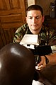 US Navy 030916-N-1528H-064 Naval Reserve Hospital Corpsman Todd Podgomy uses an auto refractor instrument.jpg