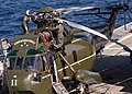 US Navy 031025-N-8955H-006 Airmen assigned to the War Lords of Light Helicopter Anti-Submarine Squadron Fifty One (HSL-51), conduct maintenance on the Commander, Seventh Fleet helicopter aboard USS Blue Ridge (LCC 19).jpg