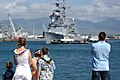 US Navy 040525-N-8157C-011 Family and friends watch as the Spruance Class destroyer USS Fletcher (DD 992) is guided to a pier by tugboats.jpg