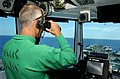 US Navy 040708-N-7232R-095 USS John C. Stennis (CVN 74) Air Boss, Cdr. David Swathwood, supervises aircraft operations from high above the flight deck.jpg