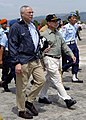 US Navy 050105-N-0057P-179 Secretary of State Colin Powell walks with the Indonesian Coordinating Minister for People's Welfare, Alawi Shihab, after departing his plane in Banda Aceh, Sumatra, Indonesia.jpg