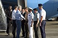 US Navy 050219-N-7293M-050 Former President William J. Clinton greets Commander, U.S. Naval Forces Marianas, Rear Adm. Arthur J. Johnson, during a fuel stop at Andersen Air Force Base.jpg