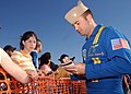 US Navy 050402-N-1328C-641 F-A-18A Hornet Slot Pilot, Lt. Cmdr. Theodore Steelman, assigned to the U.S. Navy flight demonstration team, the Blue Angels, signs autographs for fans during the Texas Thunder 2005 Air Show.jpg