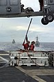 US Navy 050627-N-8604L-545 Aviation Ordnancemen hook a cargo pendant to an MH-60S Seahawk helicopter.jpg