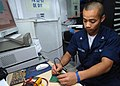 US Navy 050717-N-5526M-002 Electronics Technician 3rd Class Peter Vongmysay troubleshoots a malfunctioning amplifier card.jpg