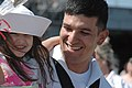 US Navy 060503-N-7987M-602 A Sailor embraces his daughter during the homecoming celebration for the amphibious transport dock USS Austin (LPD 4) at Naval Station Norfolk.jpg