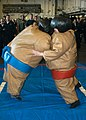 US Navy 061105-N-0730W-041 Sailors on board the amphibious assault ship USS Wasp (LHD 1) take part in a sumo-wrestling match during a steel beach picnic.jpg