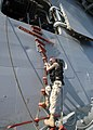 "US Navy 061121-N-8547M-020 Chief Aviation Structural Mechanic Christopher Carlson practices boarding amphibious assault ship USS Saipan (LHA 2) via a ""Jacobs ladder"" during Visit, Board, Search and Seizure (VBSS) tr.jpg"
