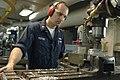 US Navy 070228-N-6274T-005 Machinery Repairman 2nd Class David J. Potter uses a milling machine to create a new WSC-8 locking block.jpg