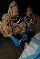 US Navy 070321-N-7780S-015 Damage Controlman 3rd Class Hunter Young, left, and Shawn Dunaway take samples from a mock anthrax pile during a Chemical, Biological, Radiological (CBR) decontamination drill.jpg