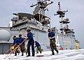 US Navy 070326-N-1328S-003 Sailors assigned to the amphibious assault ship USS Boxer (LHD 4), clean the ship's flight deck with Aqueous Film Forming Foam (AFFF).jpg