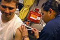 US Navy 070406-N-5627R-326 Airman Sandra Valdovinos, from Delano, Calif., administers Airman Adam Helton, from Mesa, Ariz., a Hepatitis B vaccine.jpg