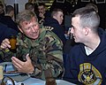 US Navy 070427-N-0606B-001 Commodore, Naval Special Warfare Group Four, Capt. Evin Thompson, talks with Seaman Recruit Kohl Curran, of Gettysburg, Penn.jpg