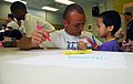 US Navy 070728-N-9928E-021 Aviation Ordnanceman 3rd Class Mark Rushing from the Nimitz-class aircraft carrier USS John C. Stennis (CVN 74) helps makes a name tag for a student at an elementary school in Hong Kong.jpg