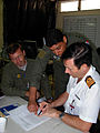 US Navy 070901-N-1713L-020 Panamanian Lt. Col. Luis Ruiz discusses last minute flight details with Argentinean pilots at Tocumen International Airport as part of the Combined Forces Air Combatant Command during PANAMAX 2007.jpg