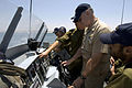 US Navy 080623-N-8273J-215 Chief of Naval Operations (CNO) Adm. Gary Roughead takes the helm aboard the Israel Navy Shaldag patrol craft, while an Israel Navy crew member explains the navigation console.jpg