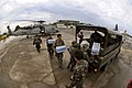US Navy 080626-N-5961C-008 Servicemen from the United States Navy and the Philippine Army work together unloading much needed supplies for people suffering in the wake of Typhoon Fengshen at Kalibo Airport.jpg