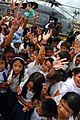 US Navy 080701-N-0640K-305 Residents from the Municipality of Balasan, Philippines wave and cheer after Sailors assigned to the.jpg
