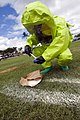 US Navy 080820-N-6674H-003 Firefighter Keala Loo, of the Pearl Harbor Fire Department, takes samples of a suspected biological agent dropped during a mock terrorist attack as part of Naval Station Pearl Harbor's Anti-Terrorism.jpg
