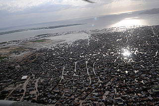 US Navy 080908-N-9774H-147 An aerial view of the devastation in Port de Paix after four storms in one month have devastated the island and killed more than 800 people.jpg