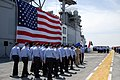 US Navy 090416-N-4846W-043 Sailors assigned to Pre-Commissioning Unit (PCU) Makin Island (LHD 8) participate in the ceremony delivering the ship from Northrop Grumman Shipbuilding, Gulf Coast to the U.S. Navy.jpg