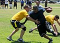 US Navy 090714-N-1424C-321 Seabees assigned to Amphibious Construction Battalion (ACB) 1 participate in the annual Captains Cup flag football competition.jpg