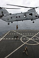 US Navy 090730-M-2547R-027 Marines assigned to Company F, 2nd Battalion, 4th Marine Regiment fast rope from a CH-46E Sea Knight helicopter onto the Military Sealift Command fleet replenishment oiler USNS Yukon (T-AO 202).jpg