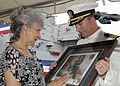 US Navy 090814-N-2645L-065 Cmdr. Brian Fort, commanding officer of the Arleigh Burke-class guided-missile destroyer USS Gonzalez (DDG 66), presents Dolia Gonzalez with a painting of her son, Marine Corps Sgt. Freddy Gonzalez.jpg