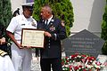 US Navy 090911-N-3283P-164 Command Master Chief Gregory Vidaurri, assigned to Commander, Fleet Activities Yokosuka, presents retired New York City Fire Department Capt. Alfredo Fuentes a letter of appreciation.jpg