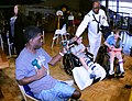 US Navy 091007-N-6220J-012 Operations Specialist 2nd Class Yusef Robertson hands out toys at Shriners Hospital for Children in Greenville during a Caps For Kids event as part of Greenville Navy Week.jpg